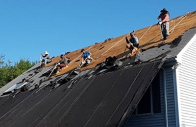 Roofers on a roof.